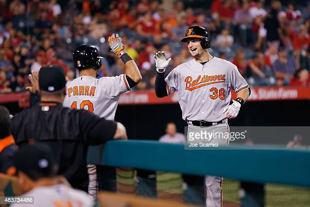 Caleb Joseph of the Baltimore Orioles celebrates with Gerardo Parra of the Baltimore Orioles after hitting a home run in the ninth inning against the...