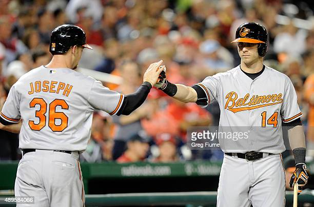 Caleb Joseph of the Baltimore Orioles celebrates with Nolan Reimold after scoring in the second inning at Nationals Park on September 22 2015 in...