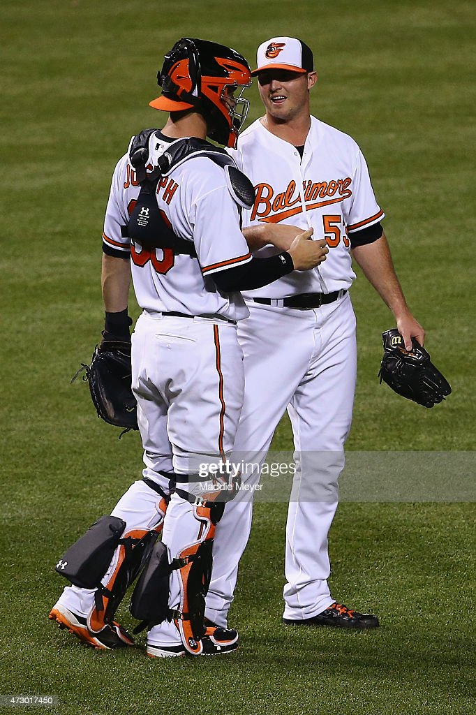 <a gi-track='captionPersonalityLinkClicked' href=/galleries/search?phrase=Caleb+Joseph+-+Baseball+Player&family=editorial&specificpeople=15741618 ng-click='$event.stopPropagation()'>Caleb Joseph</a> #36 of the Baltimore Orioles congratulates <a gi-track='captionPersonalityLinkClicked' href=/galleries/search?phrase=Zach+Britton&family=editorial&specificpeople=7091505 ng-click='$event.stopPropagation()'>Zach Britton</a> #53 after the Orioles 5-2 win over the Toronto Blue Jays at Oriole Park at Camden Yards on May 11, 2015 in Baltimore, Maryland.