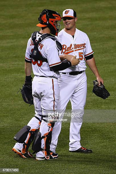 Caleb Joseph of the Baltimore Orioles congratulates Zach Britton after the Orioles 52 win over the Toronto Blue Jays at Oriole Park at Camden Yards...