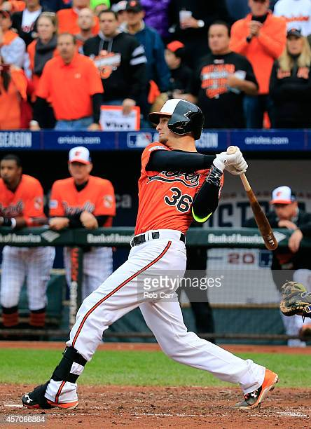 Caleb Joseph of the Baltimore Orioles hits a sacrifice fly to center field to score Steve Pearce in the second inning against Yordano Ventura of the...