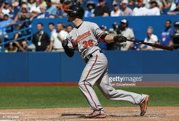 Caleb Joseph of the Baltimore Orioles hits an RBI single in the ninth inning during MLB game action against the Toronto Blue Jays on June 20 2015 at...