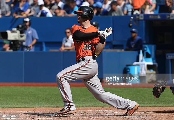 Caleb Joseph of the Baltimore Orioles hits an RBI single in the seventh inning during MLB game action against the Toronto Blue Jays on September 5...