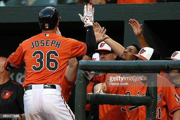 Caleb Joseph of the Baltimore Orioles is greeted in the dugout after hitting a two run home run against the Washington Nationals in the second inning...