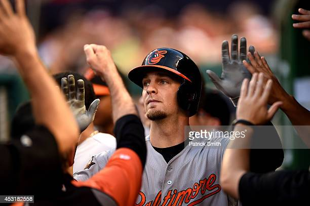 Caleb Joseph of the Baltimore Orioles is met in the dugout by teammates after hitting a solo home run in the third inning against the Washington...