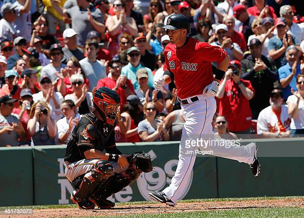 Caleb Joseph of the Baltimore Orioles looks away as Stephen Drew of the Boston Red Sox touches home plate after a home run in the second inning...