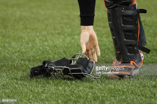 Caleb Joseph of the Baltimore Orioles picks up his mask off the turf during MLB game action against the Toronto Blue Jays at Rogers Centre on June 29...
