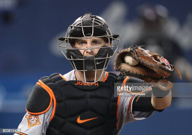 Caleb Joseph of the Baltimore Orioles reacts as he catches while crouching behind home plate during MLB game action against the Toronto Blue Jays at...