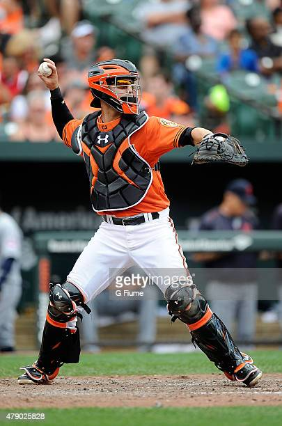 Caleb Joseph of the Baltimore Orioles throws the ball to second base against the Cleveland Indians at Oriole Park at Camden Yards on June 28 2015 in...