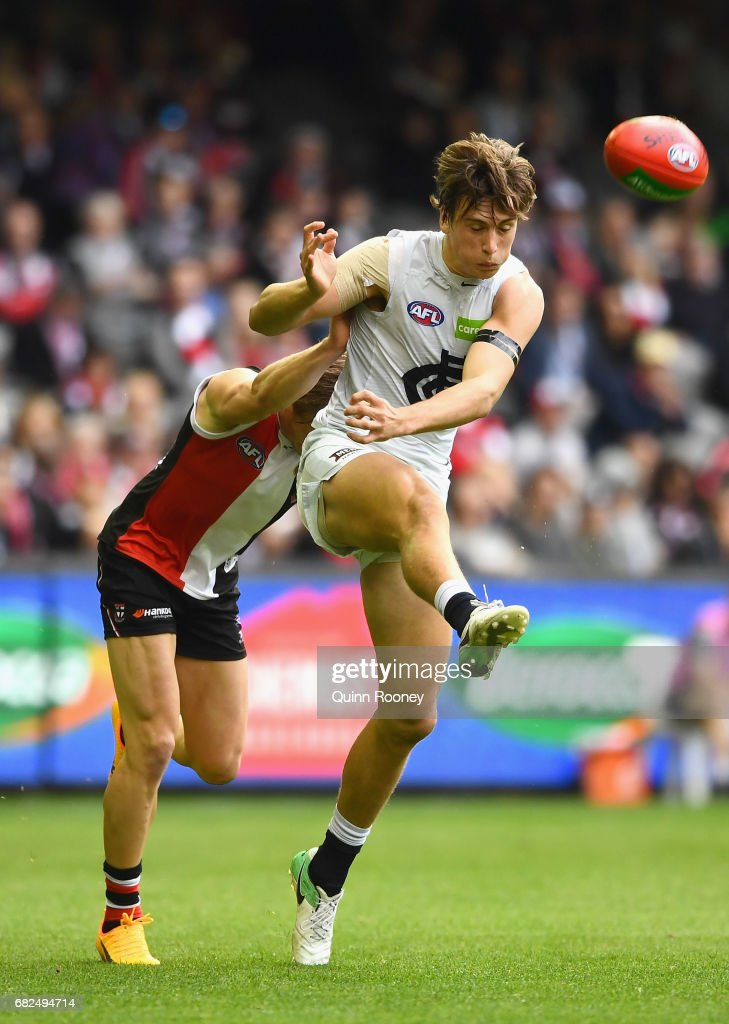 Caleb Marchbank of the Blues kicks whilst being tackled during the round eight AFL match between the St Kilda Saints and the Carlton Blues at Etihad Stadium on May 13, 2017 in Melbourne, Australia.