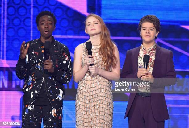 Caleb McLaughlin Sadie Sink and Gaten Matarazzo speak onstage during the 2017 American Music Awards at Microsoft Theater on November 19 2017 in Los...