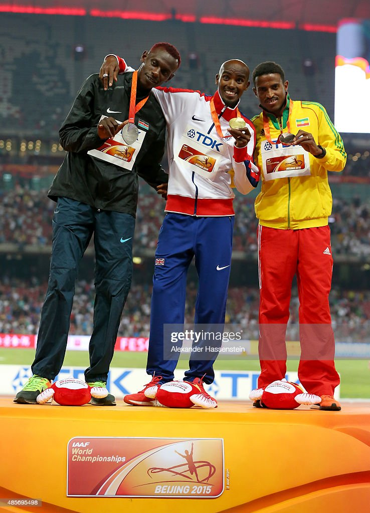 Caleb Mwangangi Ndiku of Kenya, gold medalist Mohamed Farah of Great Britain and Hagos Gebrhiwet of Ethiopia pose on the podium during the medal ceremony for the Men's 5000 metres final during day eight of the 15th IAAF World Athletics Championships Beijing 2015 at Beijing National Stadium on August 29, 2015 in Beijing, China.
