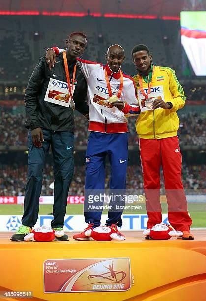 Caleb Mwangangi Ndiku of Kenya gold medalist Mohamed Farah of Great Britain and Hagos Gebrhiwet of Ethiopia pose on the podium during the medal...