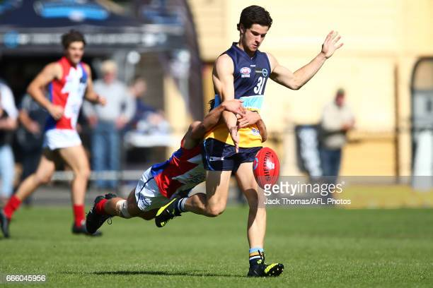 Caleb Sheahan of the Pioneers kicks the ball during the round three TAC Cup match between the Bendigo Pioneers and Gippsland Power at Queen Elizabeth...