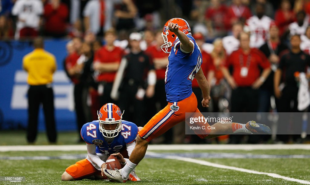 Caleb Sturgis #19 of the Florida Gators kicks against the Louisville Cardinals during the Allstate Sugar Bowl at Mercedes-Benz Superdome on January 2, 2013 in New Orleans, Louisiana.