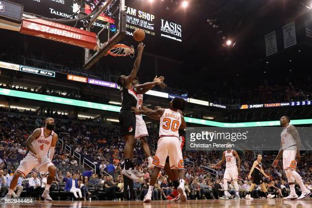 Caleb Swanigan of the Portland Trail Blazers attempts a shot against Josh Jackson of the Phoenix Suns during the second half of the NBA game at...