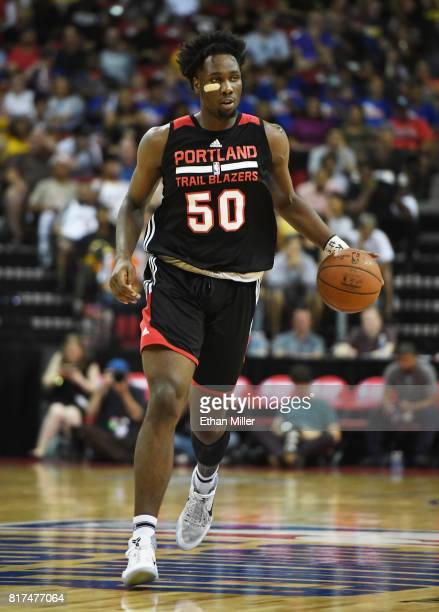 Caleb Swanigan of the Portland Trail Blazers brings the ball up the court against the Los Angeles Lakers during the championship game of the 2017...
