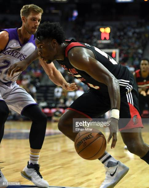 Caleb Swanigan of the Portland Trail Blazers drives against Travis Wear of the Los angeles Lakers during the championship game of the 2017 Summer...