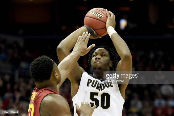 Caleb Swanigan of the Purdue Boilermakers attempts a shot while being guarded by Deonte Burton of the Iowa State Cyclones in the second half during...