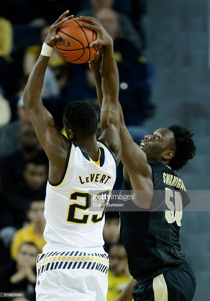 <a gi-track='captionPersonalityLinkClicked' href=/galleries/search?phrase=Caleb+Swanigan&family=editorial&specificpeople=11071332 ng-click='$event.stopPropagation()'>Caleb Swanigan</a> #50 of the Purdue Boilermakers blocks a shot by <a gi-track='captionPersonalityLinkClicked' href=/galleries/search?phrase=Caris+LeVert&family=editorial&specificpeople=9959787 ng-click='$event.stopPropagation()'>Caris LeVert</a> #23 of the Michigan Wolverines during the first half at Crisler Arena on February 13, 2016 in Ann Arbor, Michigan.