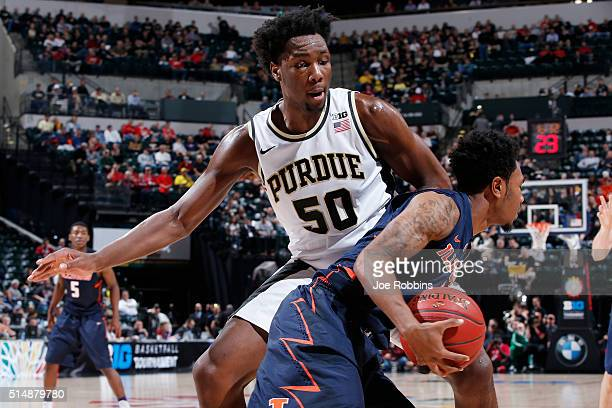 Caleb Swanigan of the Purdue Boilermakers defends against Jaylon Tate of the Illinois Fighting Illini in the quarterfinal round of the Big Ten...