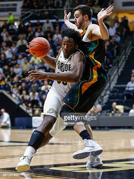 Caleb Swanigan of the Purdue Boilermakers dribbles the ball around Ethan O'Day of the Vermont Catamounts at Mackey Arena on November 15 2015 in West...