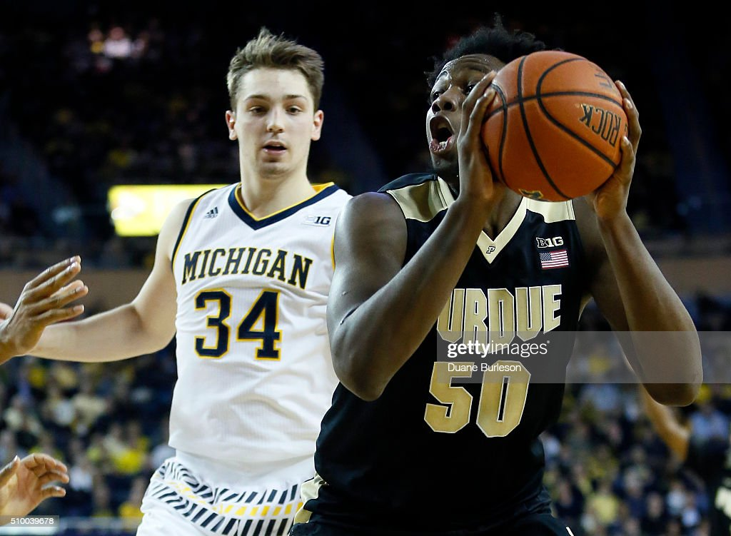 <a gi-track='captionPersonalityLinkClicked' href=/galleries/search?phrase=Caleb+Swanigan&family=editorial&specificpeople=11071332 ng-click='$event.stopPropagation()'>Caleb Swanigan</a> #50 of the Purdue Boilermakers goes to the basket against Mark Donnal #34 of the Michigan Wolverines during the second half at Crisler Arena on February 13, 2016 in Ann Arbor, Michigan. Michigan defeated Purdue 61-56.