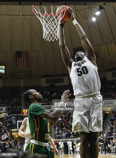 Caleb Swanigan of the Purdue Boilermakers goes up for the dunk as Carrington Ward of the Norfolk State Spartans watches at Mackey Arena on December...
