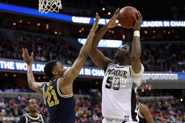Caleb Swanigan of the Purdue Boilermakers shoots over Zak Irvin of the Michigan Wolverines during the Big Ten Basketball Tournament at Verizon Center...
