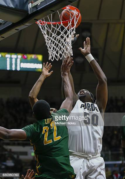 Caleb Swanigan of the Purdue Boilermakers shoots the ball against Alex Long of the Norfolk State Spartans at Mackey Arena on December 21 2016 in West...