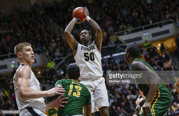 Caleb Swanigan of the Purdue Boilermakers shoots the ball over Stavian Allen of the Norfolk State Spartans at Mackey Arena on December 21 2016 in...