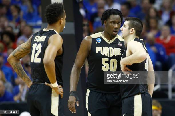 Caleb Swanigan of the Purdue Boilermakers talks to Dakota Mathias of the Purdue Boilermakers following a timeout during the 2017 NCAA Men's...