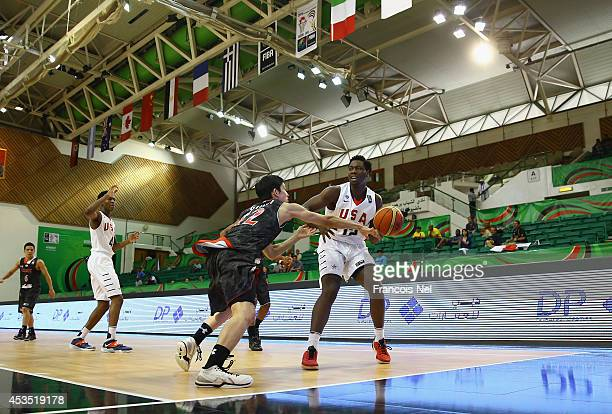 Caleb Swanigan of the United States competes for the ball with Hiroto Gunji of Japan during the FIBA U17 World Championships Group Match between...