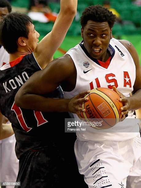 Caleb Swanigan of the United States drives the ball against Yuta Kono of Japan during the FIBA U17 World Championships Group Match between Japan and...