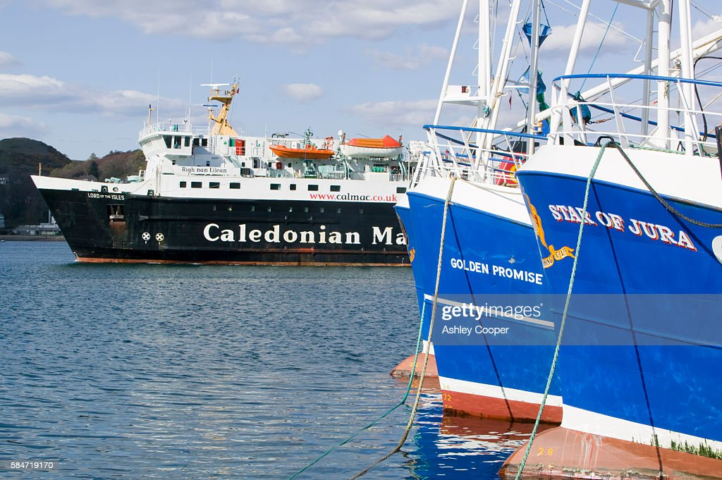 A Caledonian McBrayne ferry leaving Oban harbour Scotland