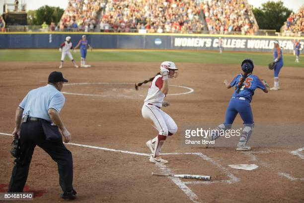 Caleigh Clifton of the University of Oklahoma cheers as she runs to home plate during Game 2 of the Division I Women's Softball Championship held at...