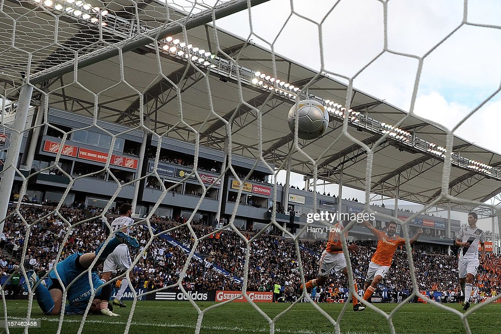 Calen Carr and Will Bruin of Houston Dynamo reacts after Carr scores a goal past Josh Saunders of Los Angeles Galaxy in the first half in the 2012...