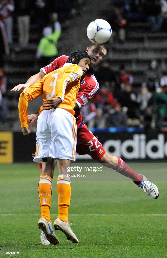 Calen Carr of Houston Dynamo and Austin Berry of Chicago Fire head the ball in an MLS match on October 31 2012 at Toyota Park in Bridgeview Illinois...