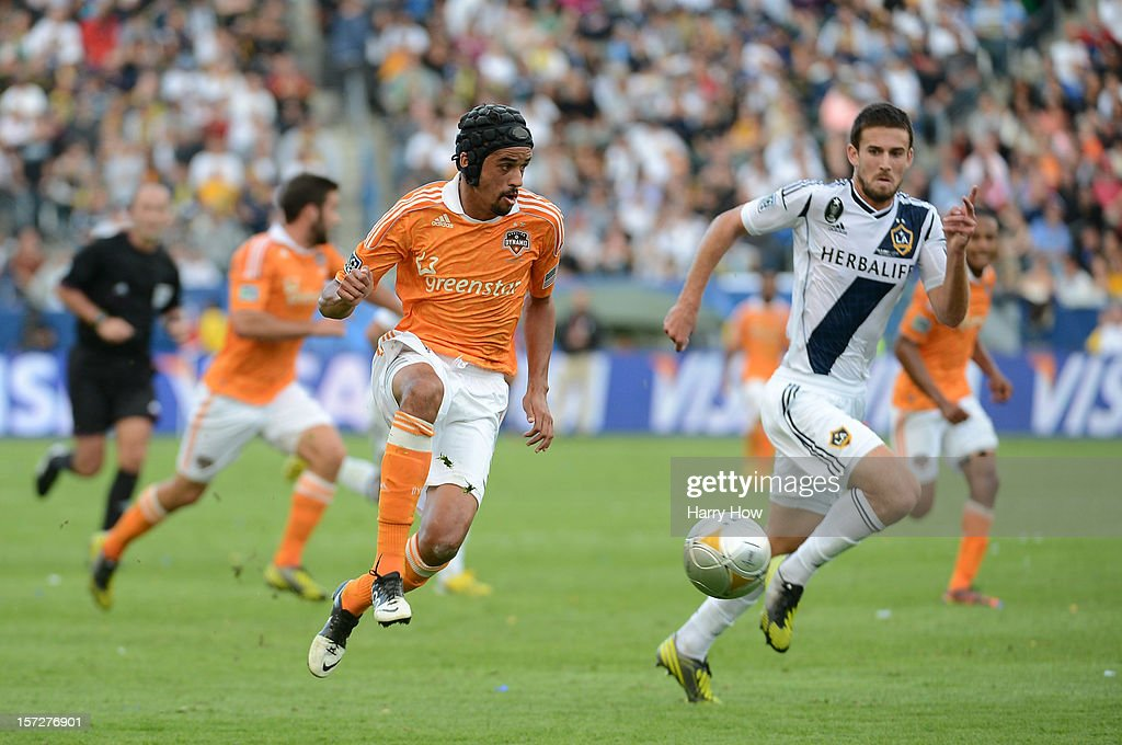 Calen Carr of Houston Dynamo kicks the ball ahead before he scores a goal against Tommy Meyer of Los Angeles Galaxy in the first half in the 2012 MLS...