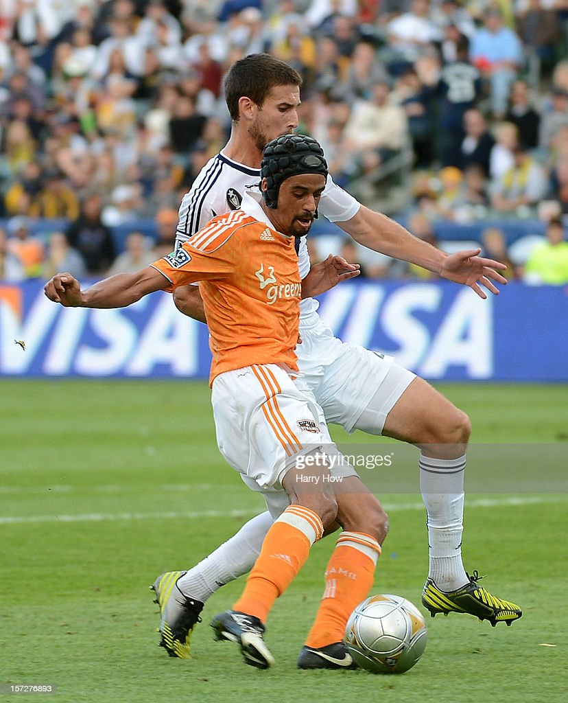 Calen Carr of Houston Dynamo scores a goal against Tommy Meyer of Los Angeles Galaxy in the first half in the 2012 MLS Cup at The Home Depot Center...