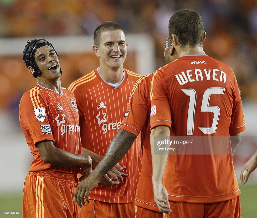 Calen Carr of the Houston Dynamo celebrates with Bobby Boswell of the Houston Dynamo and Cam Weaver of the Houston Dynamo after scoring against CD...