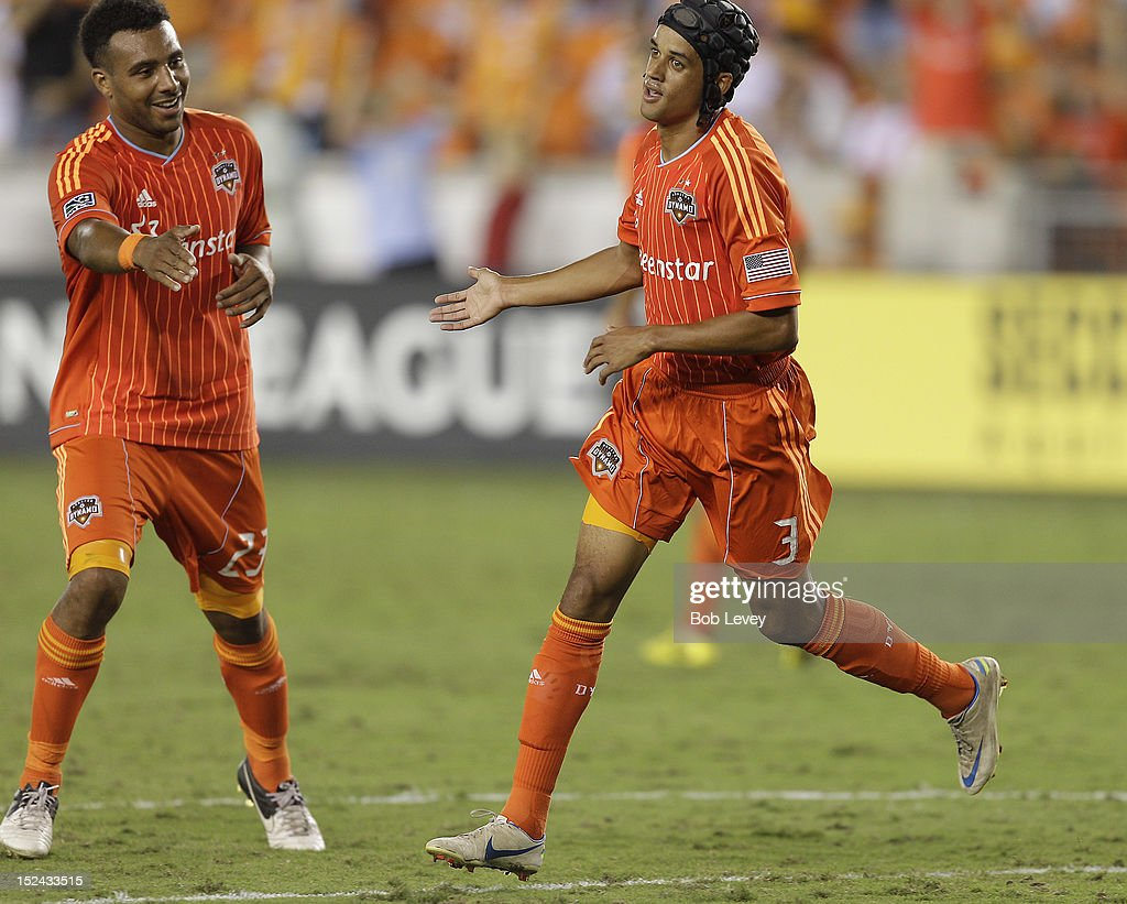 Calen Carr of the Houston Dynamo celebrates with Giles Barnes of the Houston Dynamo after scoring against the CD FAS at BBVA Compass Stadium on...