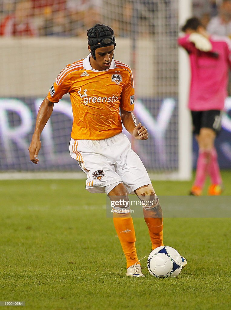 Calen Carr of the Houston Dynamo plays the ball against the New York Red Bulls during the match at Red Bull Arena on August 10 2012 in Harrison New...