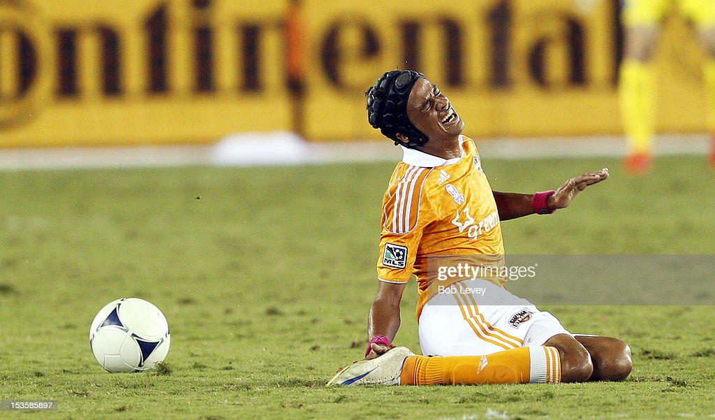Calen Carr of the Houston Dynamo winces in pain after being clipped in the first half against the Montreal Impact at BBVA Compass Stadium on October...