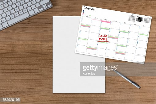 Calendar Due Date and blank sheet on wooden Table : Stock Photo