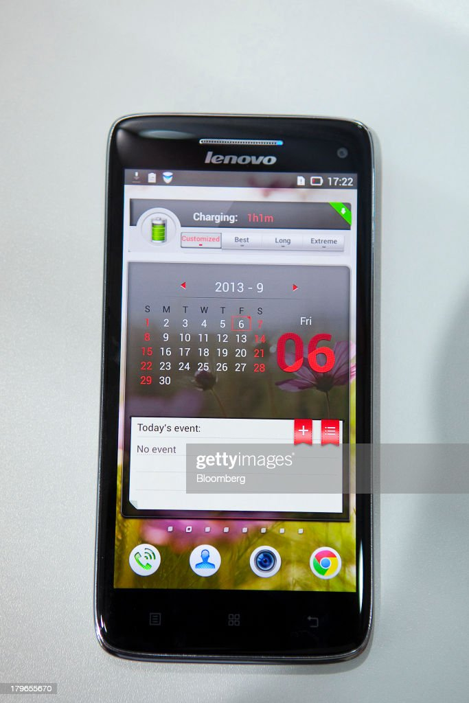 A calendar is seen displayed on the touchscreen of a Vibe X smartphone device, manufactured by Lenovo Group Ltd., at the IFA consumer electronics show in Berlin, Germany, on Friday, Sept. 6, 2013. Global smartphone revenue will rise 22 percent in 2013, or nearly half the pace of an expected 41 percent gain in shipments, amid falling prices, according to UBS. Photographer: Krisztian Bocsi/Bloomberg via Getty Images