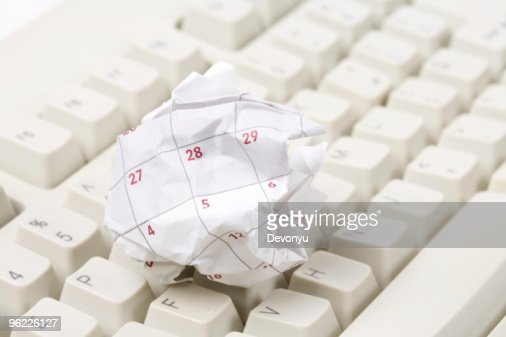 Calendar paper ball and computer keyboard : Stock Photo