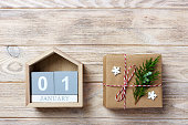 Calendar with date and gift boxes on color background. Christmas concept.