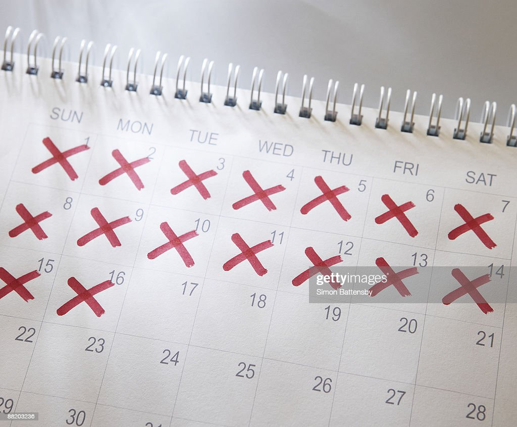 calendar with dates crossed out : Stock Photo