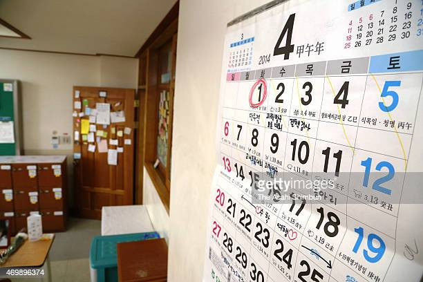 A calender displaying April 2014 remain hung in a second year classroom at Danwon High School on April 4 2015 in Ansan South Korea 325 secondyear...